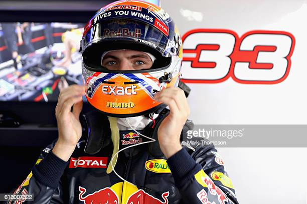 Max Verstappen of Netherlands and Red Bull Racing puts his helmet on in the garage during practice for the Formula One Grand Prix of Japan at Suzuka...
