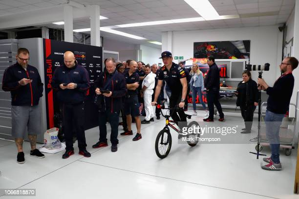 Max Verstappen of Netherlands and Red Bull Racing rides a bike around the factory during the Red Bull Racing Drivers Factory Visit at Red Bull Racing...