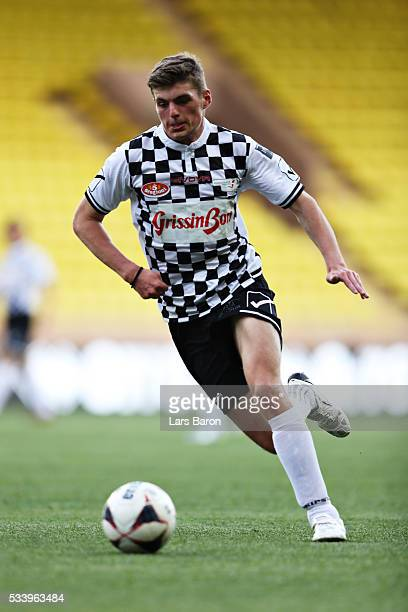 Max Verstappen of Netherlands and Red Bull Racing runs with the ball during the 24th World Stars football match at Stade Louis II, Monaco before the...