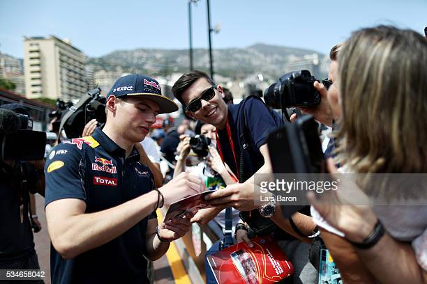 Max Verstappen of Netherlands and Red Bull Racing signs autographs for fans during previews to the Monaco Formula One Grand Prix at Circuit de Monaco...