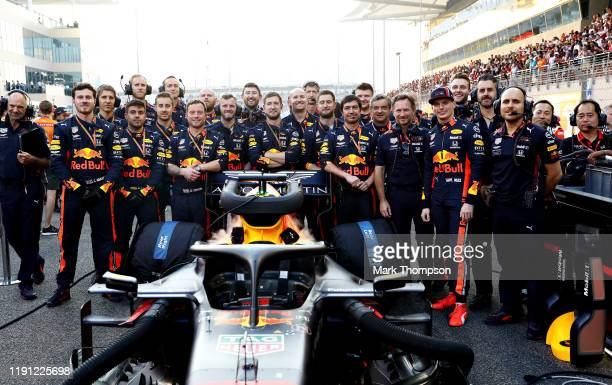 Max Verstappen of Netherlands and Red Bull Racing stands with his team on the grid before the F1 Grand Prix of Abu Dhabi at Yas Marina Circuit on...