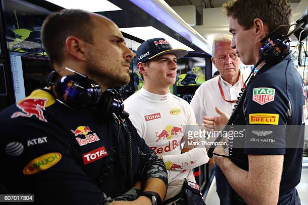 Max Verstappen of Netherlands and Red Bull Racing talks in the garage during final practice for the Formula One Grand Prix of Singapore at Marina Bay...