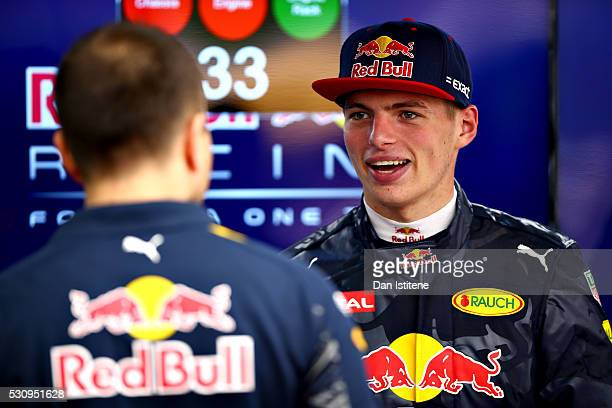 Max Verstappen of Netherlands and Red Bull Racing talks to a Red Bull Racing team member in the garage during previews to the Spanish Formula One...