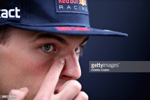 Max Verstappen of Netherlands and Red Bull Racing talks to the media in the Paddock during previews ahead of the Formula One Grand Prix of Austria at...