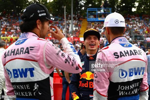 Max Verstappen of Netherlands and Red Bull Racing talks with Esteban Ocon of France and Force India and Sergio Perez of Mexico and Force India at a...