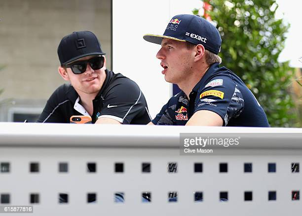 Max Verstappen of Netherlands and Red Bull Racing talks with IndyCar driver Conor Daly of United States during previews ahead of the United States...