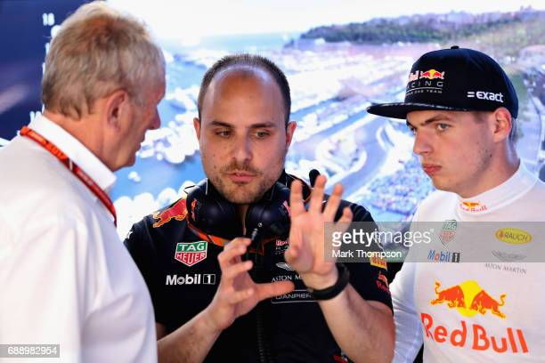 Max Verstappen of Netherlands and Red Bull Racing talks with race engineer Gianpiero Lambiase and Red Bull Racing Team Consultant Dr Helmut Marko in...
