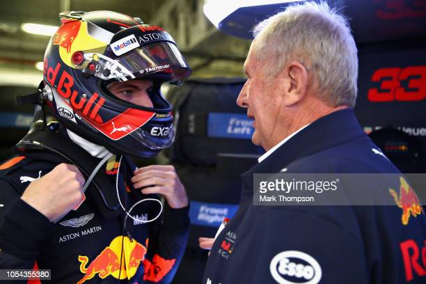 Max Verstappen of Netherlands and Red Bull Racing talks with Red Bull Racing Team Consultant Dr Helmut Marko in the garage during qualifying for the...