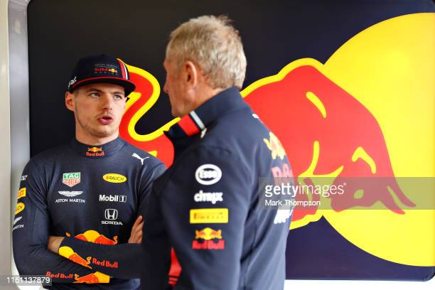 Max Verstappen of Netherlands and Red Bull Racing talks with Red Bull Racing Team Consultant Dr Helmut Marko in the garage during practice for the F1...