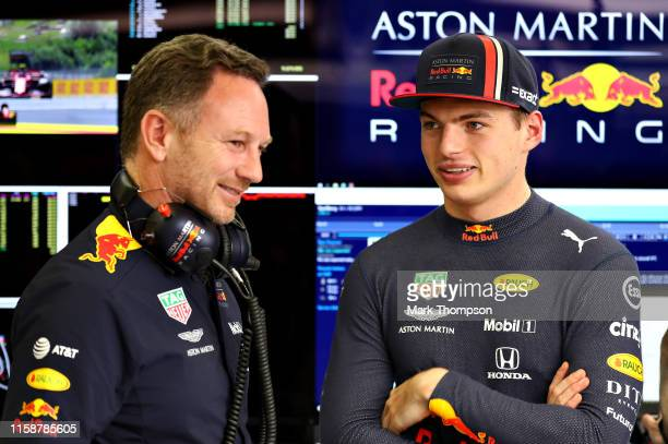 Max Verstappen of Netherlands and Red Bull Racing talks with Red Bull Racing Team Principal Christian Horner in the garage during practice for the F1...