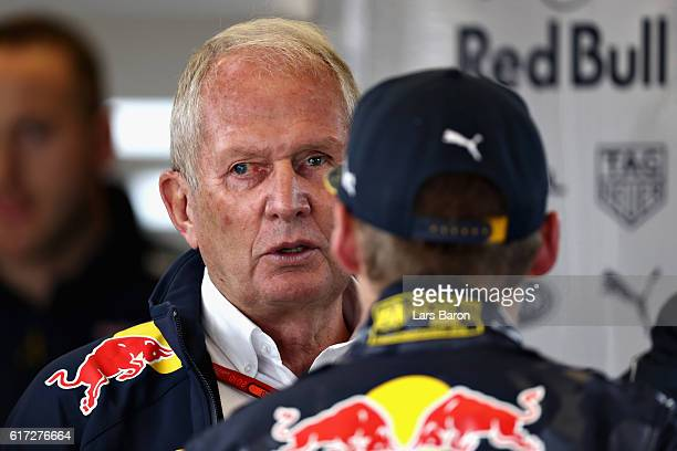 Max Verstappen of Netherlands and Red Bull Racing talks with Red Bull Racing Team Consultant Dr Helmut Marko in the garage during final practice for...