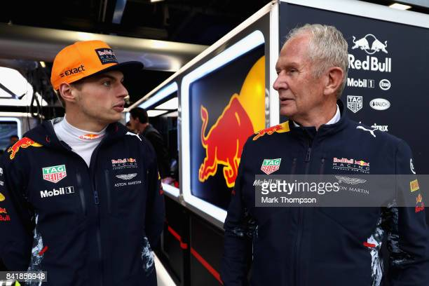 Max Verstappen of Netherlands and Red Bull Racing talks with Red Bull Racing Team Consultant Dr Helmut Marko during qualifying for the Formula One...