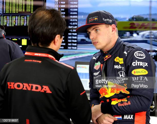 Max Verstappen of Netherlands and Red Bull Racing talks with Toyoharu Tanabe of Honda in the garage during day one of Formula 1 Winter Testing at...