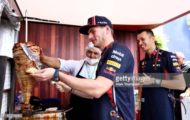 Max Verstappen of Netherlands and Red Bull Racing tries his hand at preparing tacos in the paddock during previews ahead of the F1 Grand Prix of...