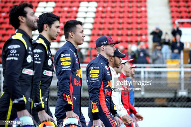 Max Verstappen of Netherlands and Red Bull Racing walks as drivers line up on the grid for a photo prior to day one of Formula 1 Winter Testing at...