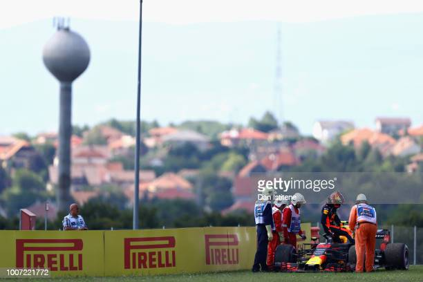 Max Verstappen of Netherlands and Red Bull Racing walks from his car after retiring during the Formula One Grand Prix of Hungary at Hungaroring on...