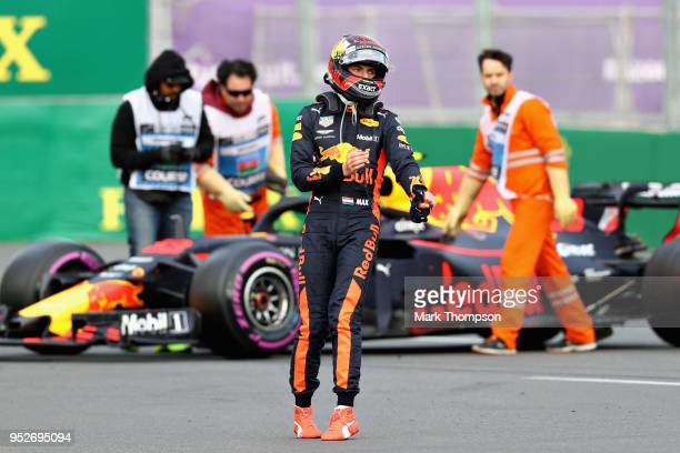 Max Verstappen of Netherlands and Red Bull Racing walks from his car after retiring during the Azerbaijan Formula One Grand Prix at Baku City Circuit...