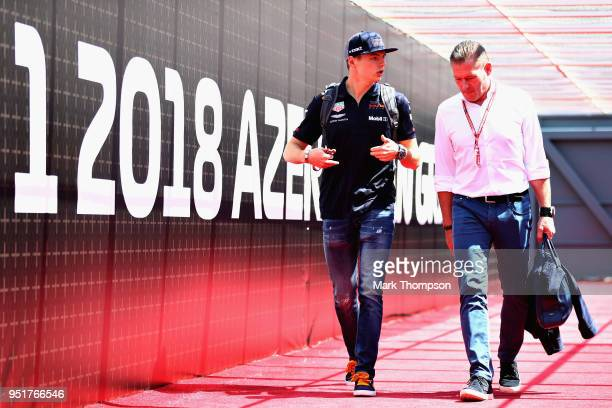 Max Verstappen of Netherlands and Red Bull Racing walks in the Paddock with father Jos Verstappen before practice for the Azerbaijan Formula One...