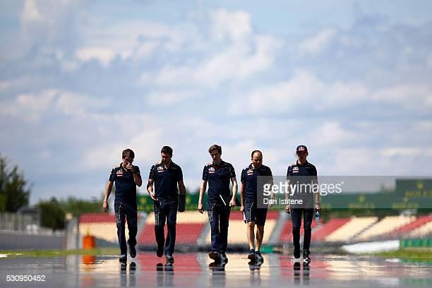 Max Verstappen of Netherlands and Red Bull Racing walks the track with Red Bull Racing team members during previews to the Spanish Formula One Grand...