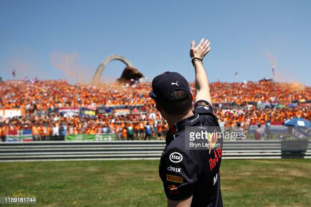 Max Verstappen of Netherlands and Red Bull Racing waves to the crowd on the drivers parade before the F1 Grand Prix of Austria at Red Bull Ring on...