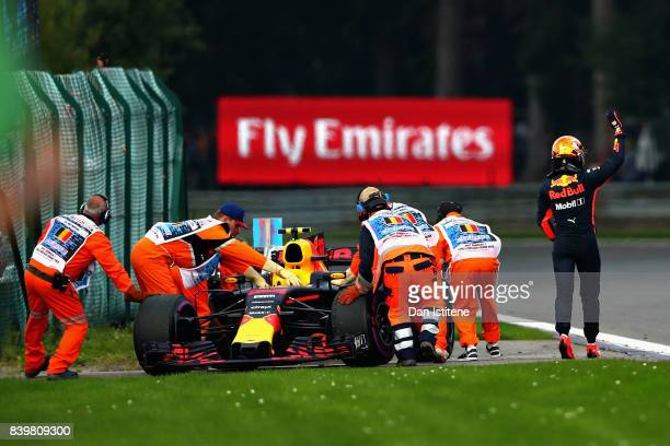 Max Verstappen of Netherlands and Red Bull Racing waves to the crowd after retiring during the Formula One Grand Prix of Belgium at Circuit de...
