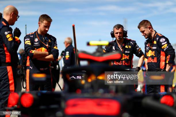 Max Verstappen of Netherlands and Red Bull Racing's team prepare his car on the grid before the United States Formula One Grand Prix at Circuit of...