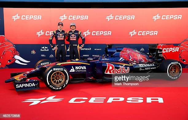 Max Verstappen of Netherlands and Scuderia Toro Rosso and Carlos Sainz Jr of Spain and Scuderia Toro Rosso pose with the new STR10 outside the team...