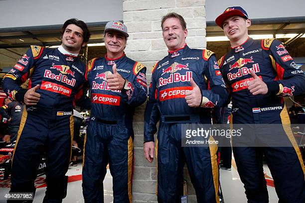 Max Verstappen of Netherlands and Scuderia Toro Rosso and Carlos Sainz of Spain and Scuderia Toro Rosso pose with their fathers Jos Verstappen and...