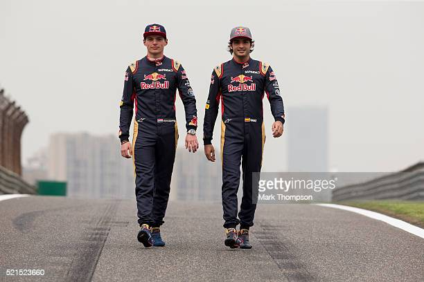 Max Verstappen of Netherlands and Scuderia Toro Rosso and Carlos Sainz of Spain and Scuderia Toro Rosso pose for a photo on the track during previews...