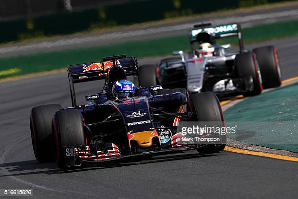 Max Verstappen of Netherlands and Scuderia Toro Rosso leads Lewis Hamilton of Great Britain and Mercedes GP during the Australian Formula One Grand...