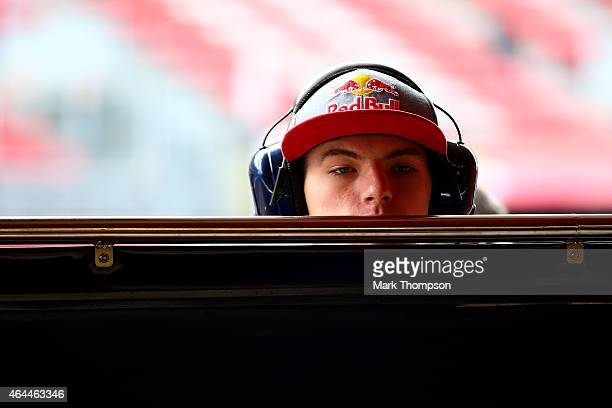 Max Verstappen of Netherlands and Scuderia Toro Rosso looks into the garage as Carlos Sainz of Spain and Scuderia Toro Rosso prepares for day one of...
