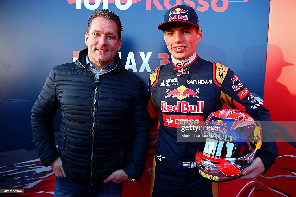 Max Verstappen of Netherlands and Scuderia Toro Rosso poses with his father Jos Verstappen after unveiling the new STR10 during previews ahead of Formula One Winter Testing at Circuito de Jerez on January 31, 2015 in Jerez de la Frontera, Spain.