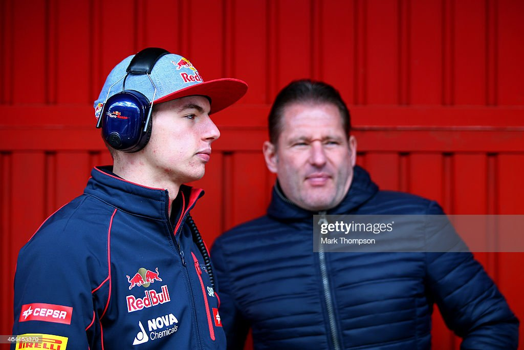 Max Verstappen of Netherlands and Scuderia Toro Rosso speaks with his father Jos Verstappen in the team garage during day one of the final Formula One Winter Testing at Circuit de Catalunya on February 26, 2015 in Montmelo, Spain.