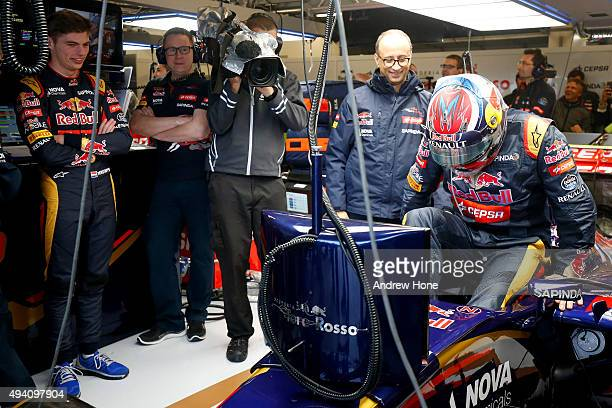 Max Verstappen of Netherlands and Scuderia Toro Rosso watches as his father Jos Verstappen gets into his car in the garage after qualifying was...