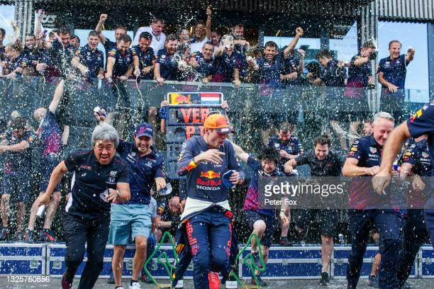 Max Verstappen of Red Bull Racing and The Netherlands and Sergio Perez of Mexico and Red Bull Racing celebrate victory with the team during the F1...