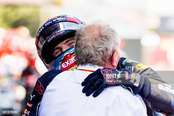 Max Verstappen of Red Bull Racing and The Netherlands celebrates winning with Red Bull Racing's Motorsport Consultant Helmut Marko of Austria during...