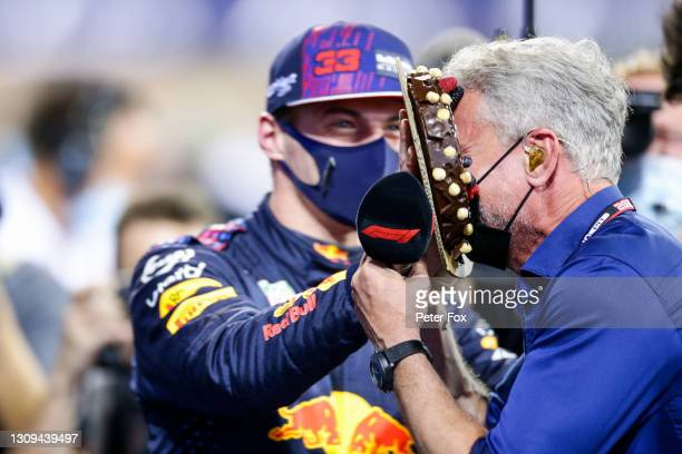 Max Verstappen of Red Bull Racing and The Netherlands congratulates David Coulthard of Great Britain on his 50th Birthday by throwing a cake in his...
