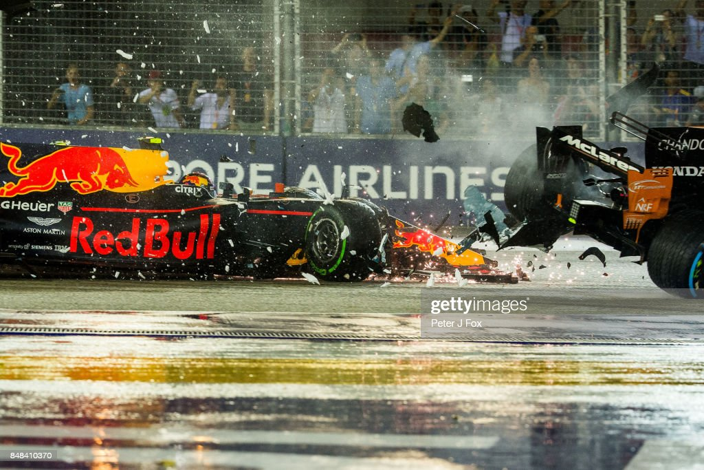 Max Verstappen of Red Bull Racing and The Netherlands crashes into Fernando Alonso of McLaren and Spain during the Formula One Grand Prix of Singapore at Marina Bay Street Circuit on September 17, 2017 in Singapore.