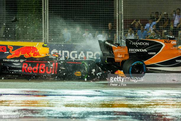 Max Verstappen of Red Bull Racing and The Netherlands crashes into Fernando Alonso of McLaren and Spain during the Formula One Grand Prix of...