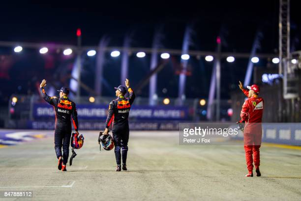 Max Verstappen of Red Bull Racing and The Netherlands Daniel Ricciardo of Australia and Red Bull Racing Sebastian Vettel of Ferrari and Germany...