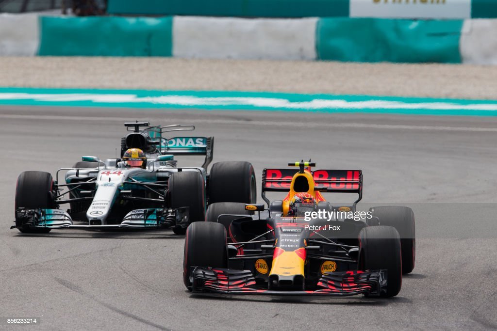 Max Verstappen of Red Bull Racing and The Netherlands over takes Lewis Hamilton of Mercedes and Great Britain to take the lead during the Malaysia Formula One Grand Prix at Sepang Circuit on October 1, 2017 in Kuala Lumpur, Malaysia.
