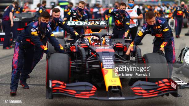 Max Verstappen of the Netherlands and Red Bull Racing is pushed on to the grid by his team before the F1 Grand Prix of France at Circuit Paul Ricard...