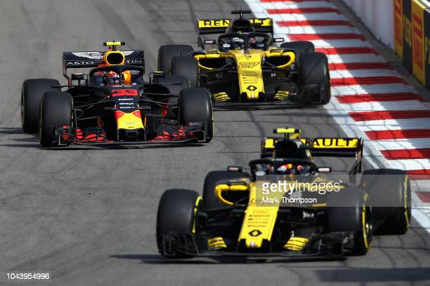 Max Verstappen of the Netherlands driving the Aston Martin Red Bull Racing RB14 TAG Heuer overtakes Nico Hulkenberg of Germany driving the Renault...