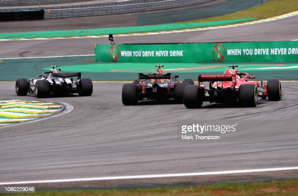 Max Verstappen of the Netherlands driving the Aston Martin Red Bull Racing RB14 TAG Heuer overtakes Kimi Raikkonen of Finland driving the Scuderia...