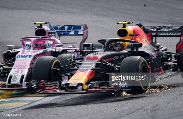 Max Verstappen of the Netherlands driving the Aston Martin Red Bull Racing RB14 TAG Heuer is crashed into by Esteban Ocon of France driving the...