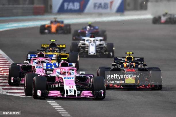 Max Verstappen of the Netherlands driving the Aston Martin Red Bull Racing RB14 TAG Heuer battles with Esteban Ocon of France driving the Sahara...