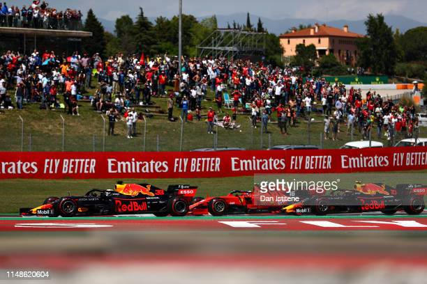 Max Verstappen of the Netherlands driving the Aston Martin Red Bull Racing RB15 Charles Leclerc of Monaco driving the Scuderia Ferrari SF90 and...