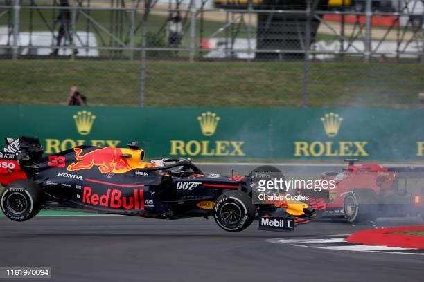 Max Verstappen of the Netherlands driving the Aston Martin Red Bull Racing RB15 and Sebastian Vettel of Germany driving the Scuderia Ferrari SF90...