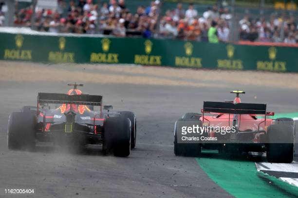 Max Verstappen of the Netherlands driving the Aston Martin Red Bull Racing RB15 runs wide as he battles for track position with Charles Leclerc of...