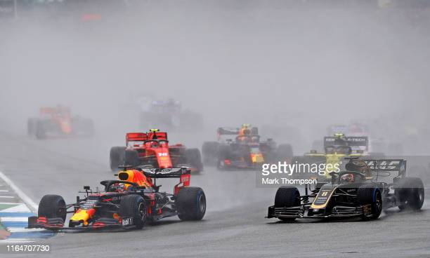 Max Verstappen of the Netherlands driving the Aston Martin Red Bull Racing RB15 leads Romain Grosjean of France driving the Haas F1 Team VF19 Ferrari...